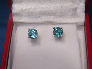 TRUE BLUE...PAIR OF 14KT WHITE GOLD BLUE ZIRCON STUD EARRINGS...