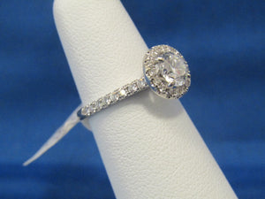 14KT ROUND DIAMOND HALO DESIGNED SOLITAIRE RING.  .80CT CENTER...GREAT STONE!