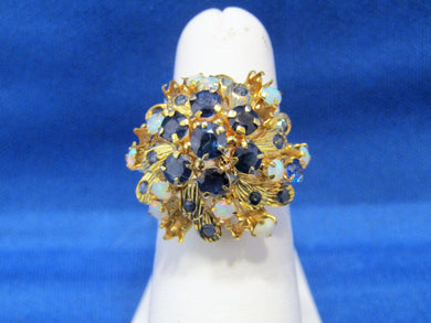 PRINCESS SAPPHIRE AND OPAL CLUSTER RING, CIRCA 1960'S