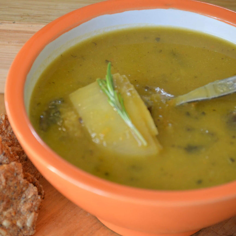 Warm and cozy soup made from chopped leeks and chunks of portobello mushrooms with hints of pureed carrots, celery and onion within homemade veggie broth.