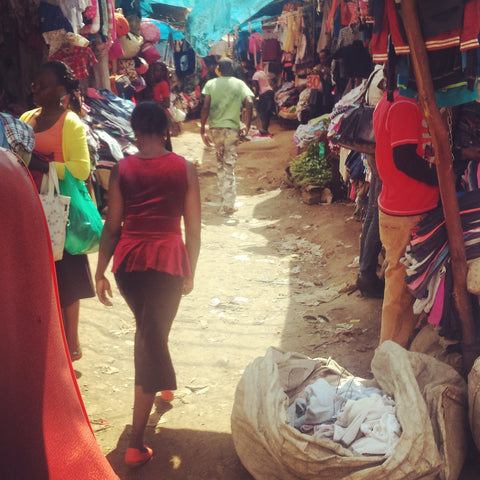 A Kenyan walking through Toi Market