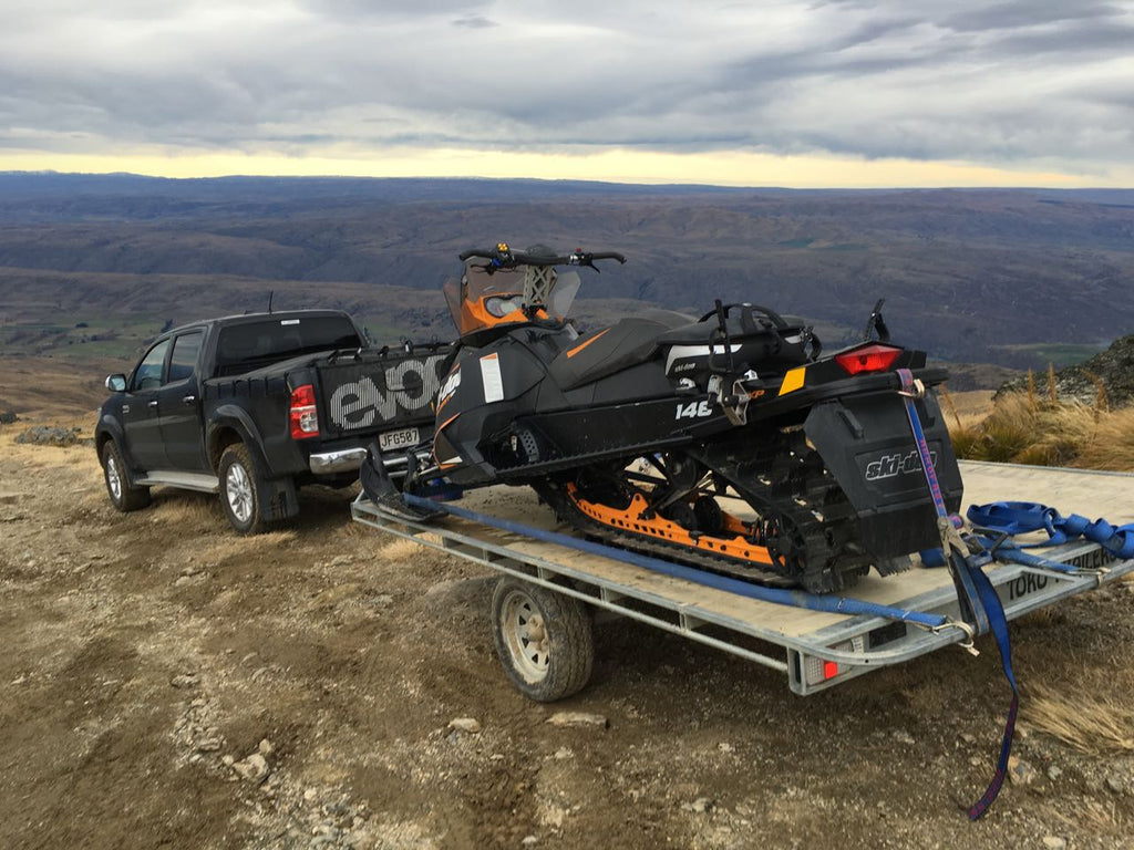 Skidoo Summit Snowmobile on trailer. Old Man Range South Island NZ