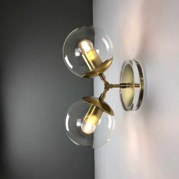 brass visage globe sconce lighting