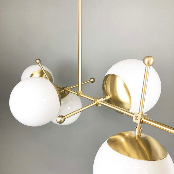 brass cumula globe chandelier lighting