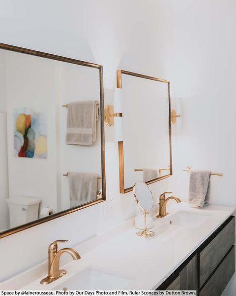 white brass Ruler Sconce vanity lighting by Dutton Brown. Space by @lainerousseau. Photo by Our Days Photo and Film.