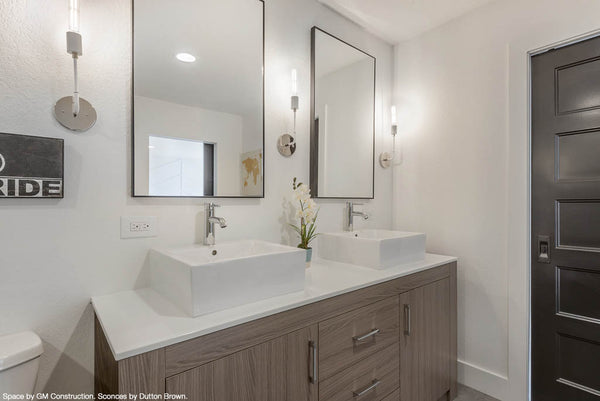 white nickel tall snug sconce wall lighting bathroom vanity lighting dutton brown. Space by GM Construction.