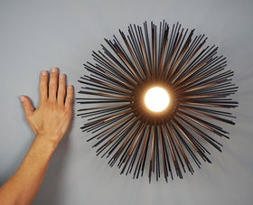 _hover black urchin sconce wall lighting with hand
