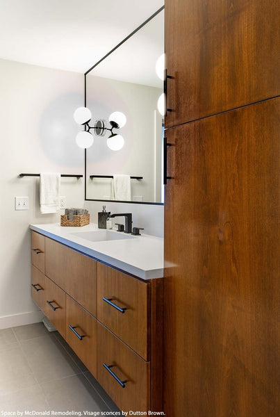 black visage globe sconce bathroom vanity lighting by Dutton Brown. Space by McDonald Remodeling.