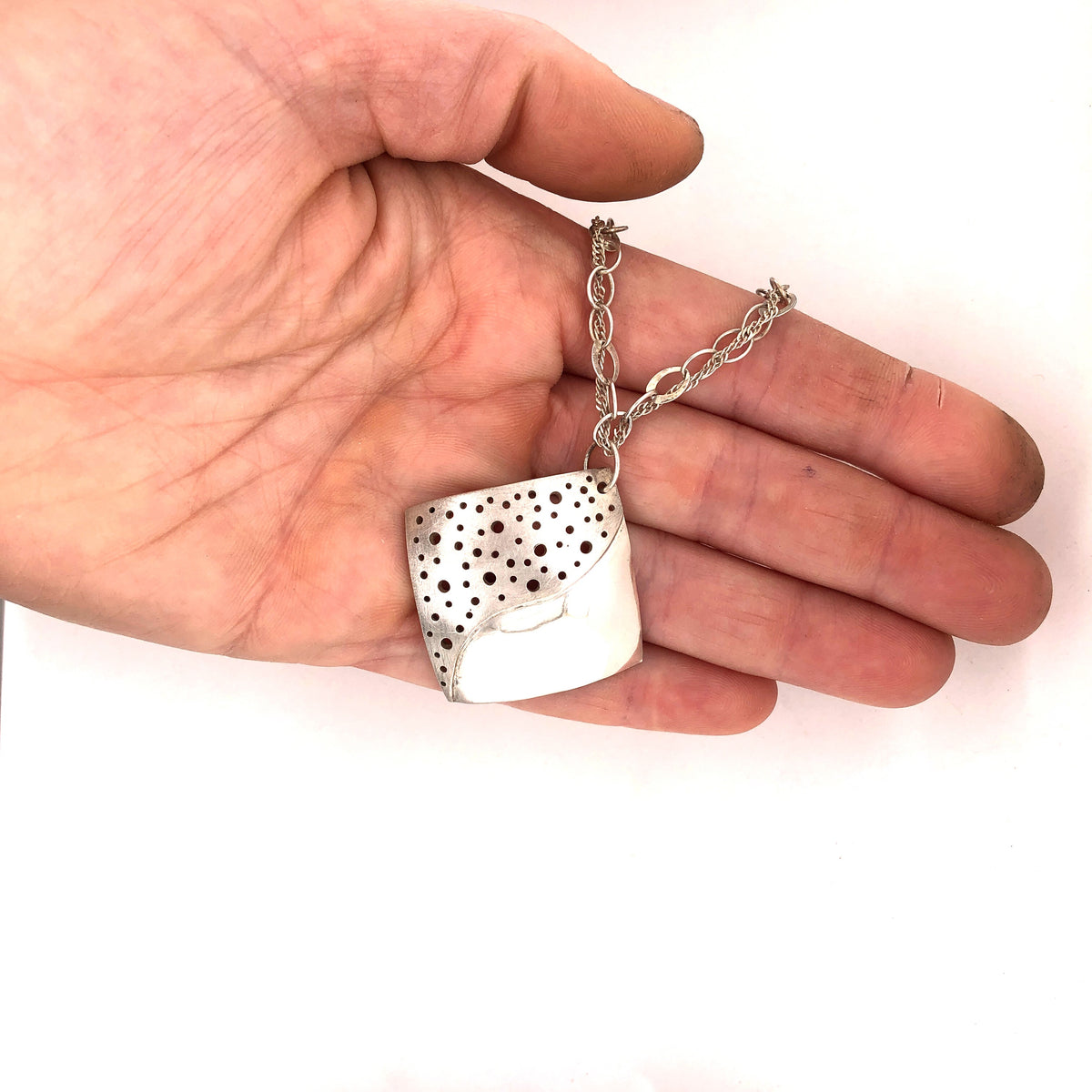 Drilled Holes Pendant