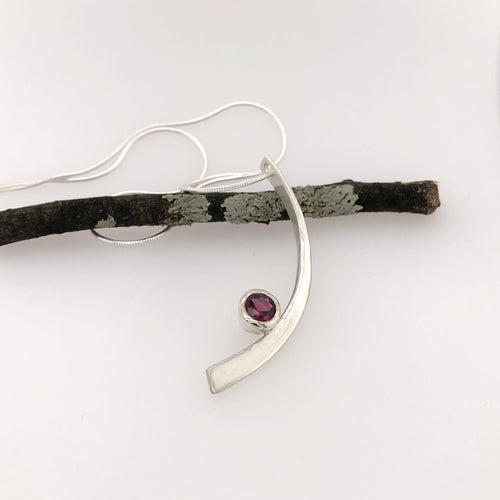 Forged Curve Pendant with Garnet