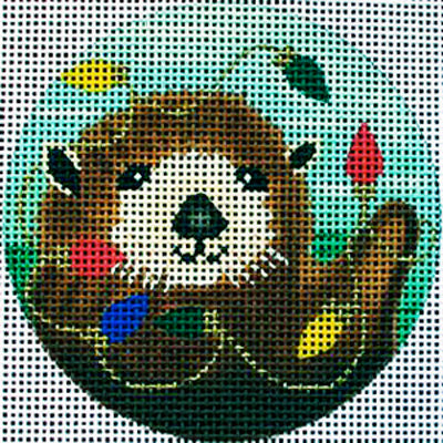 Amanda Lawford whimsical and fun round needlepoint canvas of sea otter holding multicolored Christmas lights