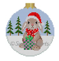 Susan Roberts needlepoint canvas Christmas ornament (round with ball top) of a bunny rabbit holding a present wearing a Santa hat with snow and pine trees