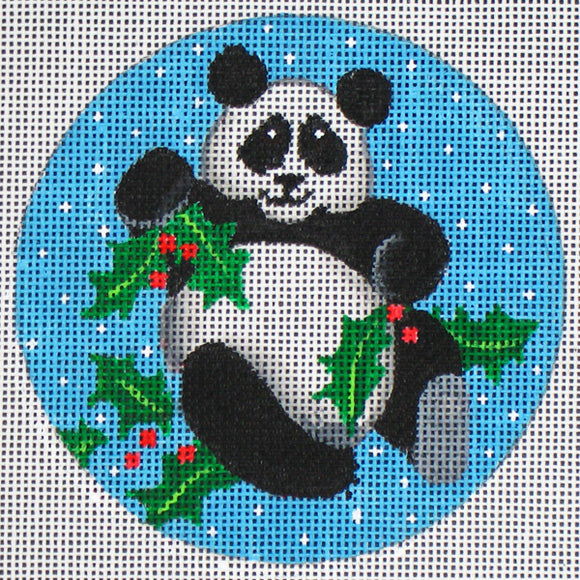 DC designs round needlepoint canvas of a panda holding holly leaves on a snowy background