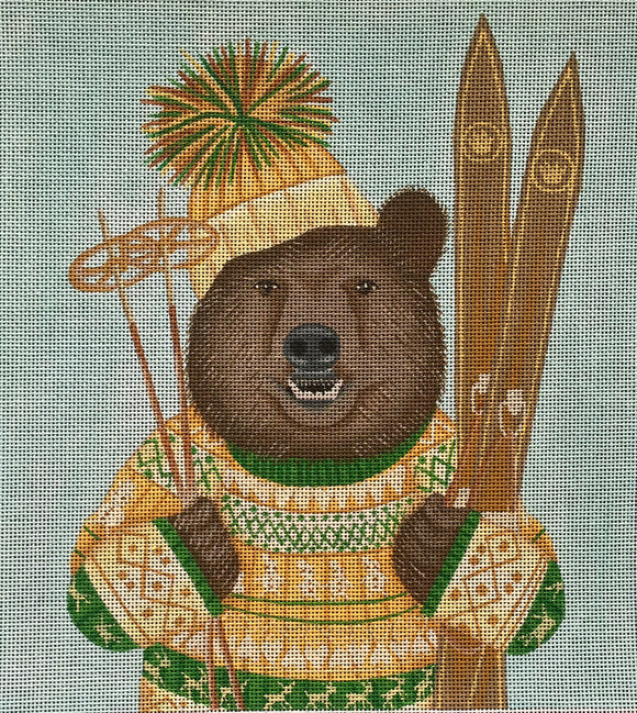 Fab Funky whimsical needlepoint canvas of a brown bear wearing a fair isle sweater and a pom pom beanie hat holding skis and ski poles