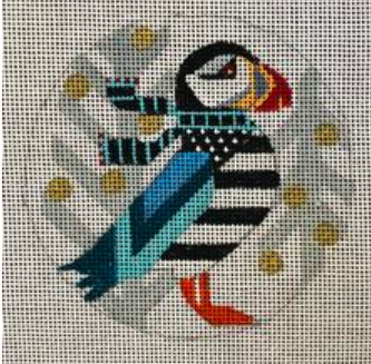 Melissa Prince geometric colorful round needlepoint canvas of puffin wearing a scarf with winter trees