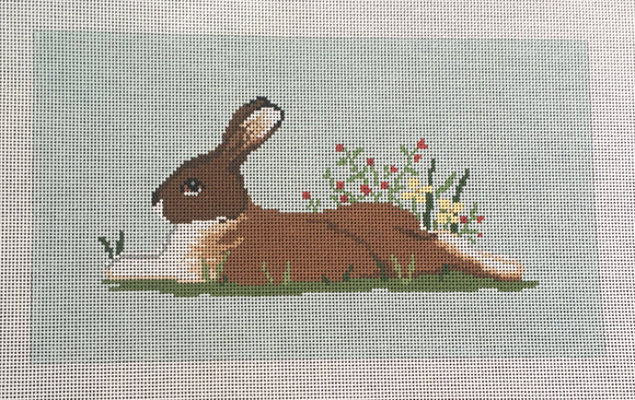 Susan Roberts needlepoint canvas of a resting bunny rabbit with flowers