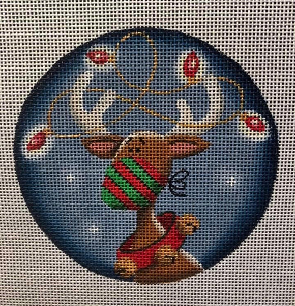 Round Christmas ornament reindeer wearing a face mask with lights in the antlers and a jingle bell collar Rebecca Wood needlepoint canvas