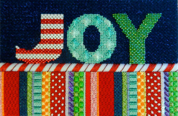 Associated Talents needlepoint canvas of the word Joy with candy cane border and stripes