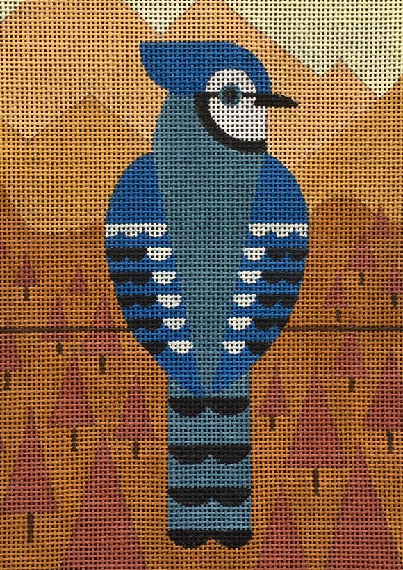 Scott Partridge needlepoint canvas of a geometric blue jay on a wire with orange geometric trees and mountains in the background for a fall and autumnal landscape