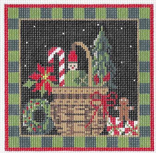 Kelly Clark needlepoint canvas of a Christmas basket with gingerbread and poinsettia and a checkered border