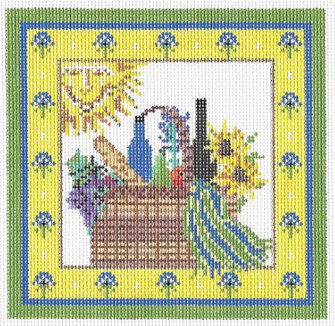 Kelly Clark needlepoint canvas of a picnic basket with a French baguette bread and wine with a smiling sun and a Provence French country border