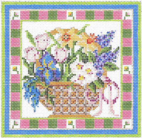 Kelly Clark needlepoint canvas of a springtime flower basket with irises and daffodils
