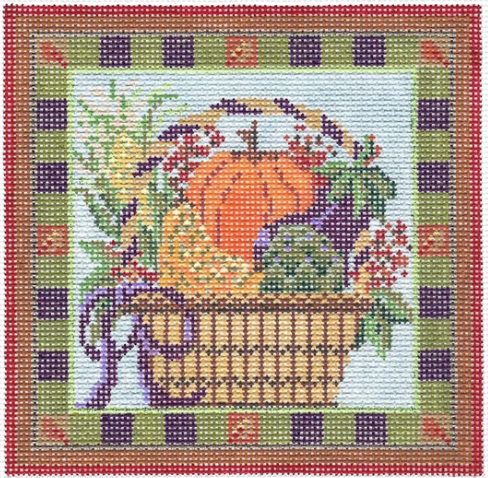 Kelly Clark needlepoint canvas of a fall basket with pumpkin, artichoke, and eggplant with a striped border