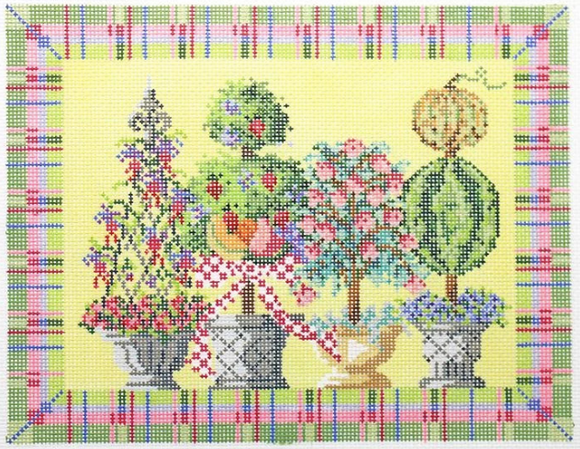 Kelly Clark needlepoint canvas of four topiaries with bright plaid border