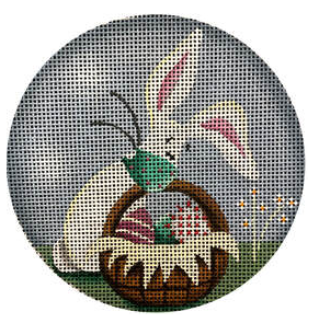 Rebecca Wood round needlepoint canvas of a Covid-19 era easter bunny with a basket of easter eggs and the coronavirus