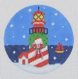 Pepperberry round needlepoint canvas of a lighthouse with a wreath decorated for Christmas with snow and a sailboat in the background