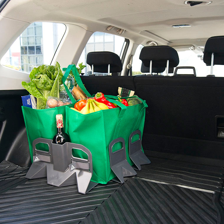 Stayhold shopping bag holders for cargo liners holding two large bags of groceries and shopping in the back of an SUV