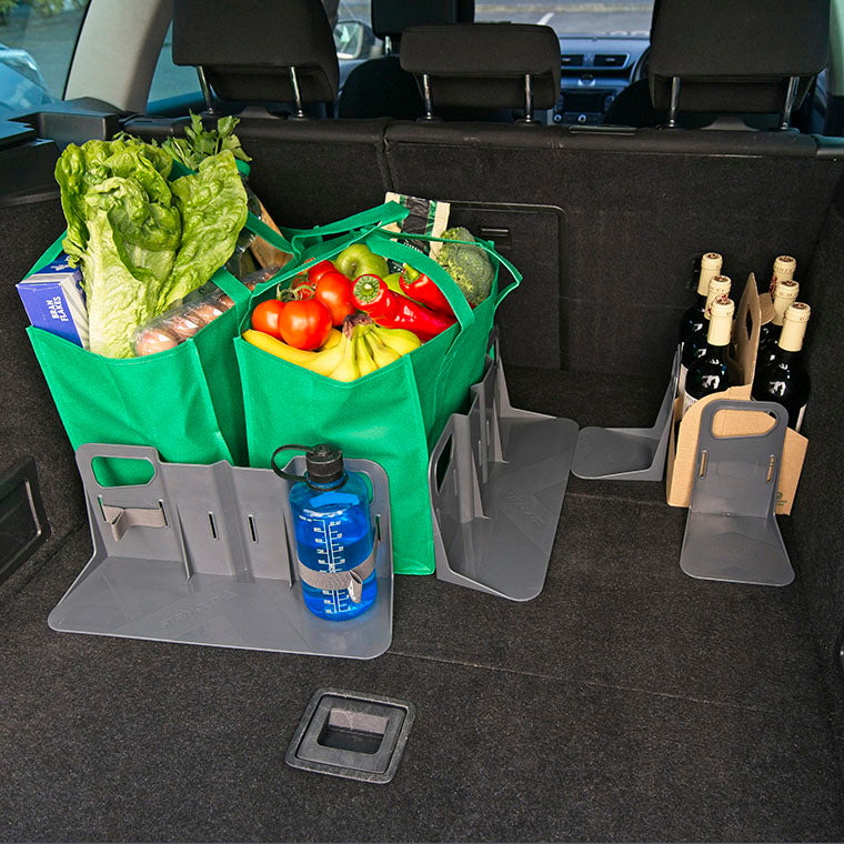 set of stayhold cargo organizers holding bags of shopping and wine bottles in the car trunk