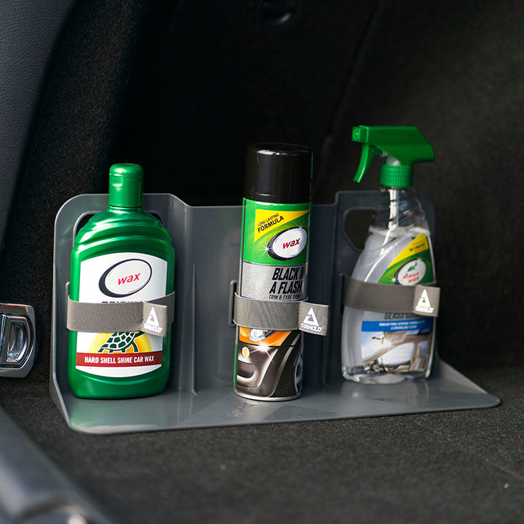 Stayhold cargo holder with straps holding bottles and sprays