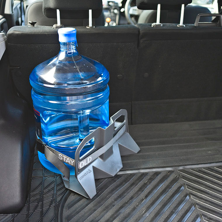 Stayhold cargo holder for trunk liners holding large water bottle with strap