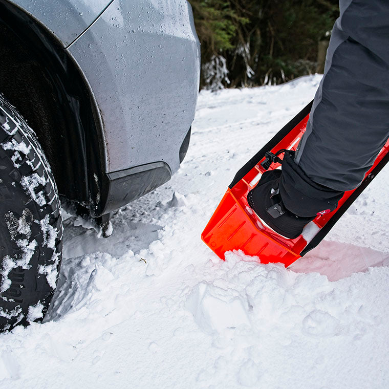 digging a car out of snow with a Stayhold safety snow shovel