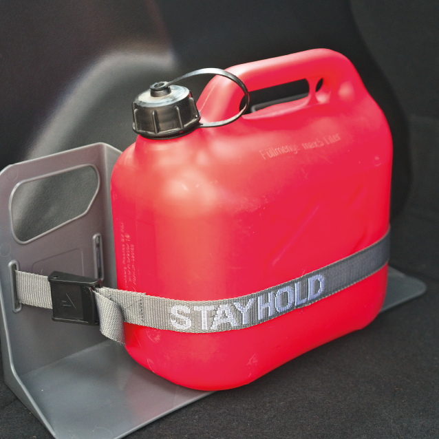 Stayhold trunk organizer holding a large bottle with an adjustable strap