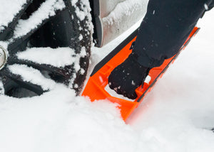 Stayhold Compact Safety Shovel clearing snow from around a car