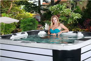 Image of a woman relaxing in a luxury hot tub spa