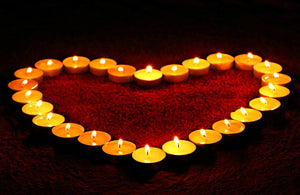 Tea lights arranged into a heart shape