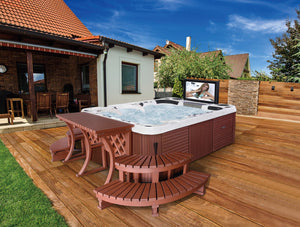 Luxury hot tub spa with steps and table