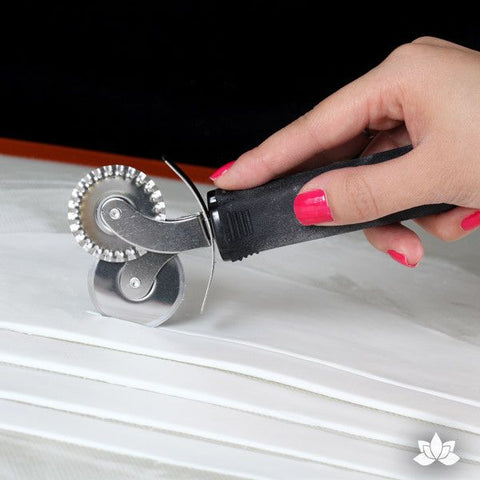 The dual head FondX cutter is two tools in one with a non-slip soft grip, perfect for trimming that extra FondX on your cake or for cutting ribbons. Size: 6.5""
