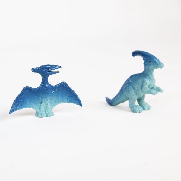 Dinosaur shaped decorations for cakes and cupcakes