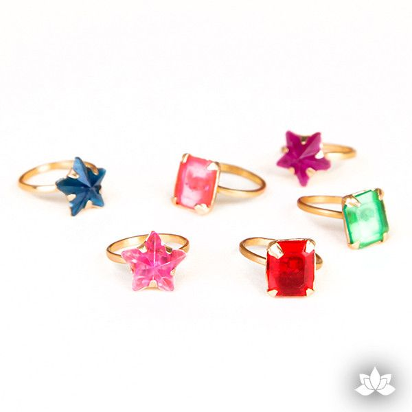 Top off your cupcakes with Star and Prism Gold Rings. They'd make cute toppers and take-home favors for your kid's parties.