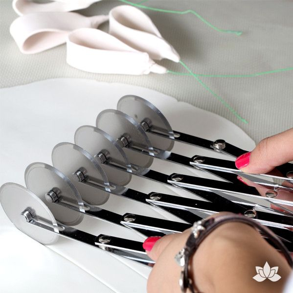 "5 Ribbon Fondant Cutter has 6 adjustable blades which cut ribbons up to 5"" wide, 5 ribbons at a time. Perfect for cake decorators who make ribbons & loops. Fondant Tool"