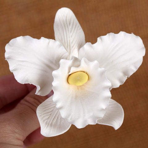 White Cattleya Orchid Sugarflower cake topper great for cake decorating wedding cakes. | CaljavaOnline.com