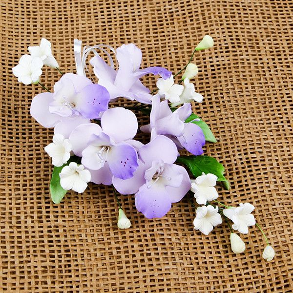 Cooktown Orchid Sprays in Lavender are gumpaste sugarflower cake decorations perfect as cake toppers for cake decorating fondant cakes and wedding cakes. Caljava wholesale cake supply.