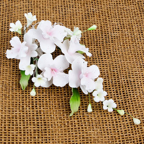 Cooktown Orchid Sprays in Pink are gumpaste sugarflower cake decorations perfect as cake toppers for cake decorating fondant cakes and wedding cakes. Caljava wholesale cake supply.