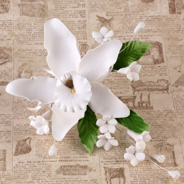 White Gumpaste Orchid Spray Cake topper sugar flower spray perfect for cake decorating fondant wedding cakes and fondant custom cakes.  Wholesale sugar flowers and wholesale cake supply.