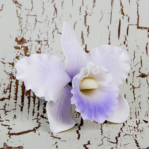 Small Cattleya Orchids in Lavender are the perfect flower for weddings, birthdays, and a variety of celebrations.  Adding a sense of refinement and innocence to your creations, these gorgeous orchids can be easily placed on cakes and are sure to draw attention.  Readymade by hand from gumpaste, these Small Cattleya Orchid gumpaste flowers offer a way of decorating cakes hassle free for both professional and amateur decorators.