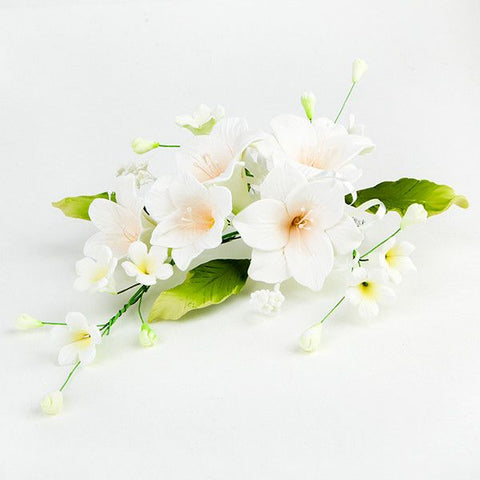 Open Lily Sprays in Peach are gumpaste sugarflower cake decorations perfect as cake toppers for cake decorating fondant cakes and wedding cakes. Caljava wholesale cake supply.
